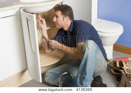 Plumber Working On Sink