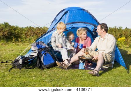 Families Camping With Tent And Cooking