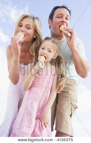 Families Standing Outdoors With Ice Cream