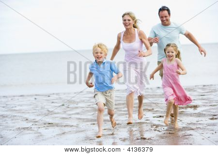 Families Running On Beach Smiling