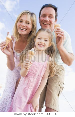 Families Standing Outdoors With Ice Cream Smiling