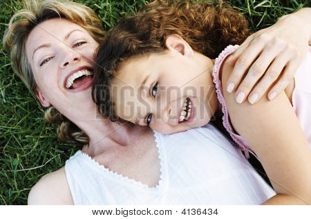 Mother And Daughter Outdoors Smiling