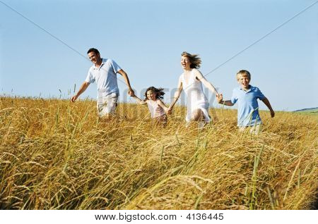 Families Running Outdoors Holding Hands Smiling
