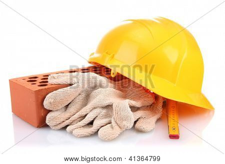 helmet, roulette, brick and gloves isolated on white