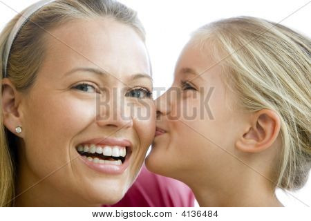 Young Girl Kissing Smiling Woman