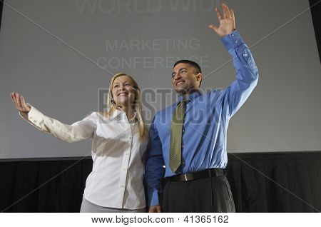 Low angle view of business people giving a lecture while gesturing