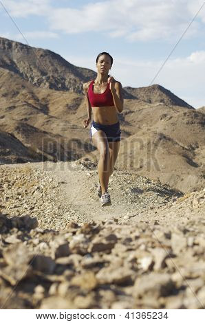 Beautiful Mixed race woman jogging in mountains