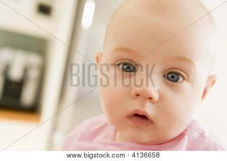Baby'S Face In Kitchen