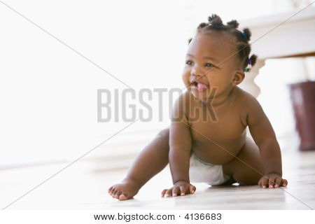 Baby Crawling Indoors Smiling