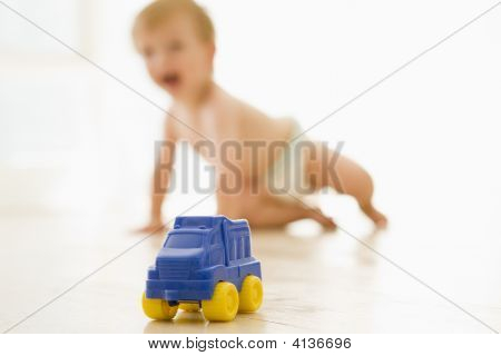 Baby Indoors With Toy Truck