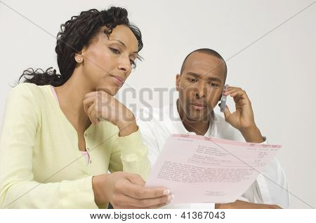 Low angle view of an African American couple reading document