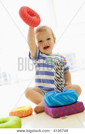 Baby Indoors Playing With Soft Toy
