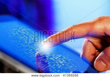 Closeup of finger touching tablet-pc screen