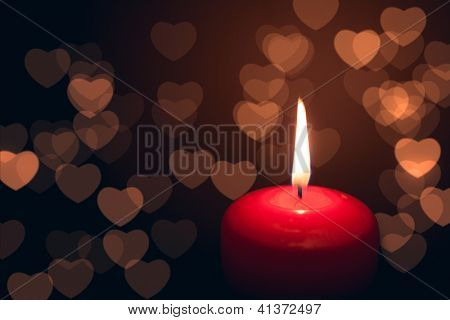 candle with hearts bokeh
