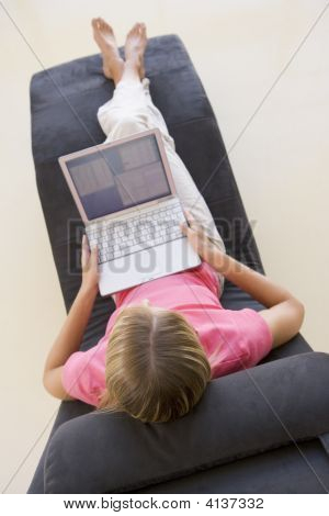 Woman Sitting In Chair Using Laptop