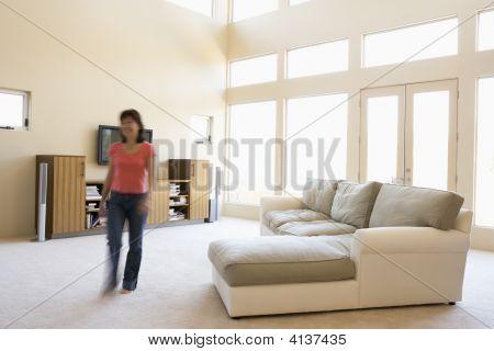 Woman Walking Through Living Room