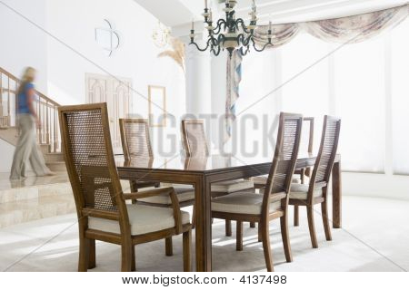 Woman Walking By Dining Room