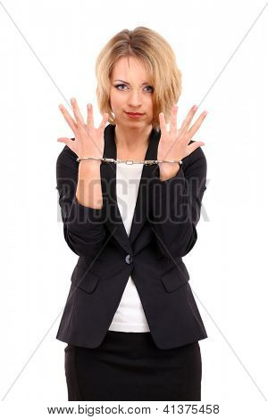 Young beautiful business woman in handcuffs isolated on white