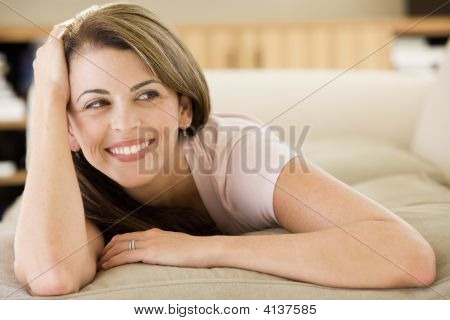 Woman Lying In Living Room
