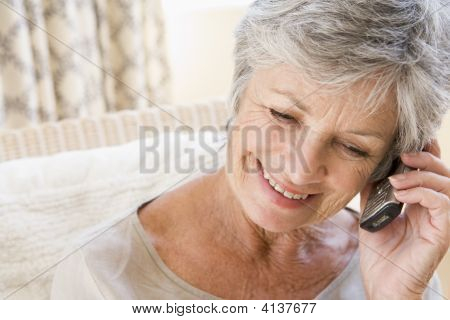 Woman Indoors Using Cellular Phone