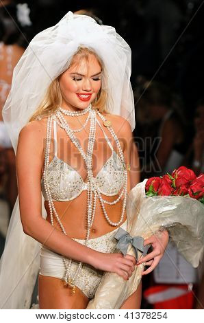 MIAMI - July 14: Model Kate Upton getting ready backstage at the Beach Bunny Swimsuit Collection for