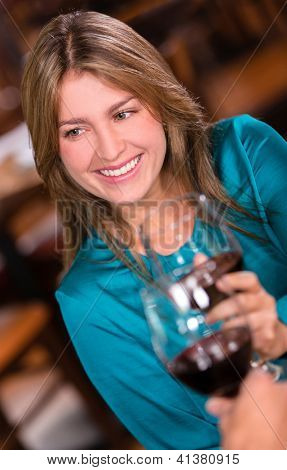 Beautiful woman making a toast and drinking wine