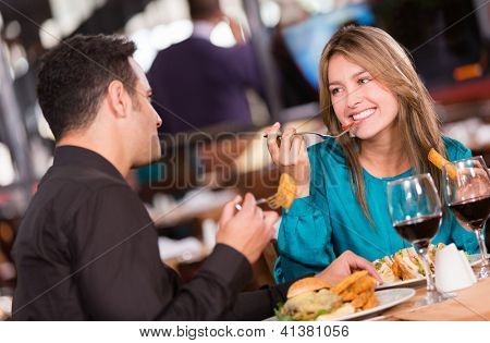 Friends eating at a restaurant  and looking happy