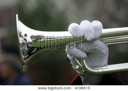 Hand on trumpet