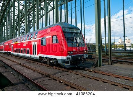 Red Train On Bridge