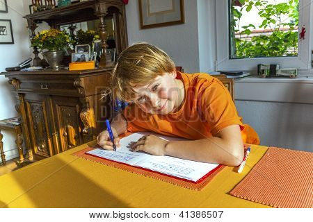 Boy Prepares His Homework For School