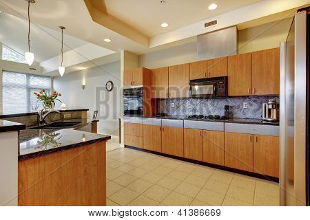 Large Modern Wood Kitchen With Living Room And High Ceiling.