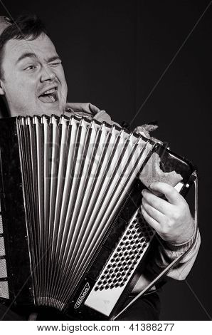 Russian man plays the accordion and sings