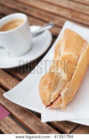 Bocadillo (seranito) and coffe