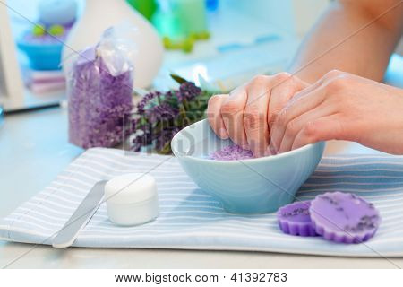 Client Soaks Her Hands In A Bowl Of Fragrant Water Before Manicure