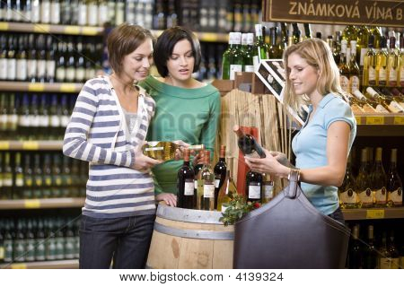 Three Women Buying Wine