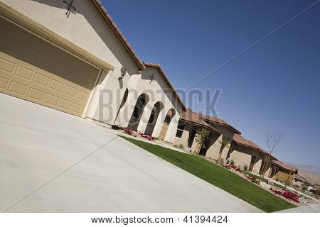 Tilt image of a raw of houses against blue sky