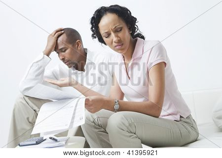 Worried African American couple over domestic bills