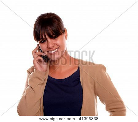 Young Woman Looking At You Speaking On Cellphone