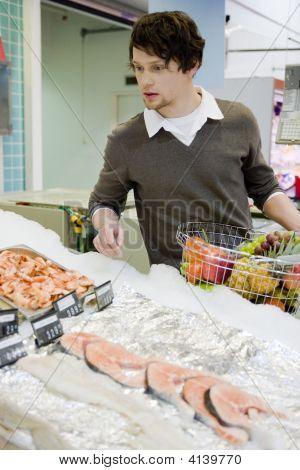 Young Man At Supermarket