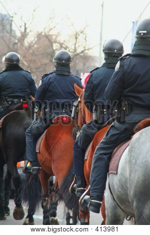 Anti-riot Police On Horse Back