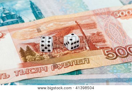 Two Dice Laying Over A Pile Russian Money