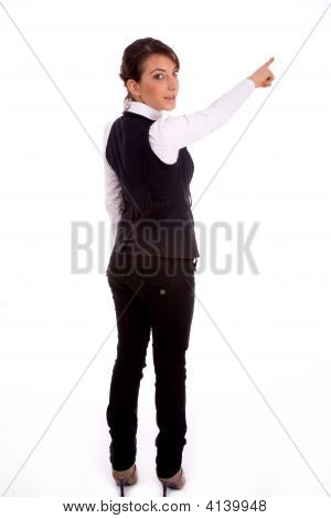 Backpose Of Pointing Businesswoman