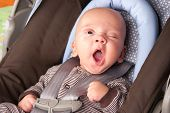 pic of yawning  - Portrait of a yawning baby Boy In Safety Seat - JPG