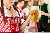 image of stein  - Young people in traditional Bavarian Tracht in restaurant or pub - JPG
