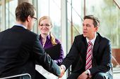 picture of interview  - Man having an interview with manager and partner employment job candidate hiring resume CEO work business shaking hands - JPG