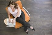 Businesswoman Sitting Indoors With Laptop Smiling
