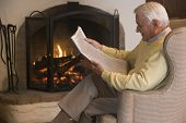 picture of current affairs  - Close up of man sat infront of an open fire - JPG