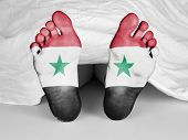stock photo of unnatural  - Dead body under a white sheet flag of Syria - JPG