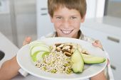 stock photo of healthy food  - Portrait of young girl looking disappointed with plate of healthy food - JPG