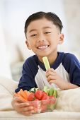 picture of fruits vegetables  - Portrait of young boy eating a cookie - JPG